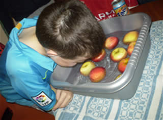 duckin apple. A Youth Club member gets his head stuck in for an apple!
