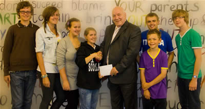 Members of St. Andrew's Youth Club present £300 to the Lourdes Sick Fund
