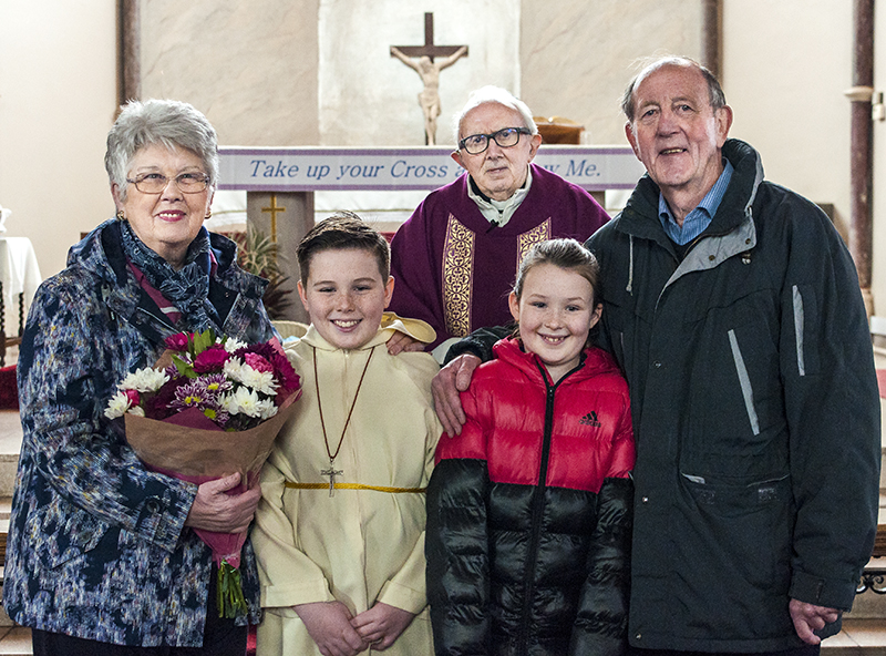 Kath and Mick McNicholas with Fr. Jack McKeever and grandchildren Luke and Grace.