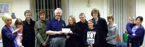 Members of St. Andrew's Youth Cabinet present £350 proceeds of concert to Zoe's Place.