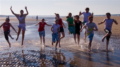 Some of the youth club members in the sea during the  2009 Beachwalk