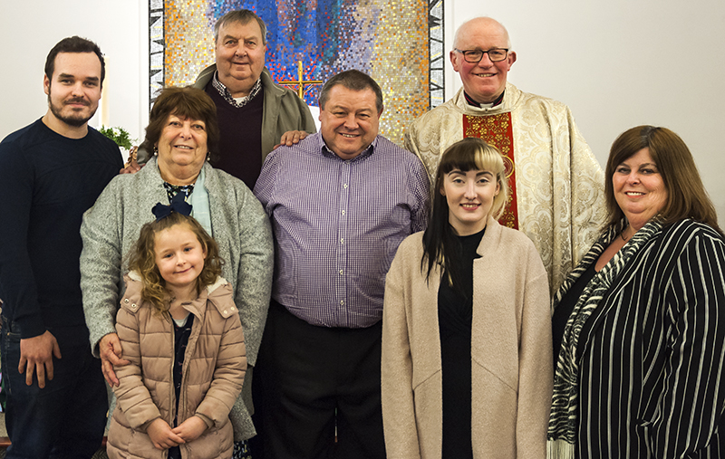 David James, centre, pictured with members of his family at the end of the Easter Vigil.