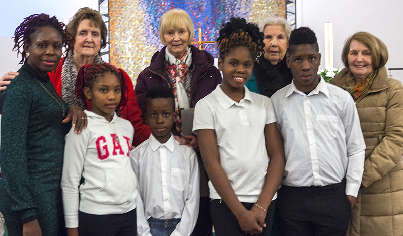 Precious, Comfort, Wisdom and Success Emmanuel-Olu are pictured above with their mother and members of the Legion of Mary who were also their God Parents.