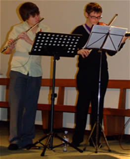 St. Andrew's Youth band members play the flute and violin