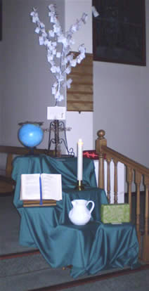 offertory smbols placed below intentions tree