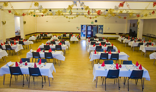 The main hall set out for a Christmas dinner