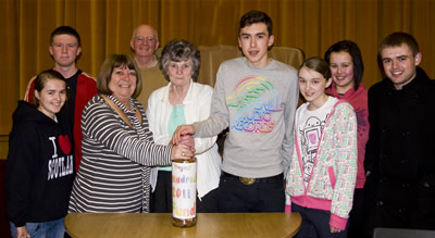 The bingo bottle of loose change is handed over to the Madrid Fund