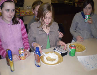 Youth Club members get stuck into pancakes